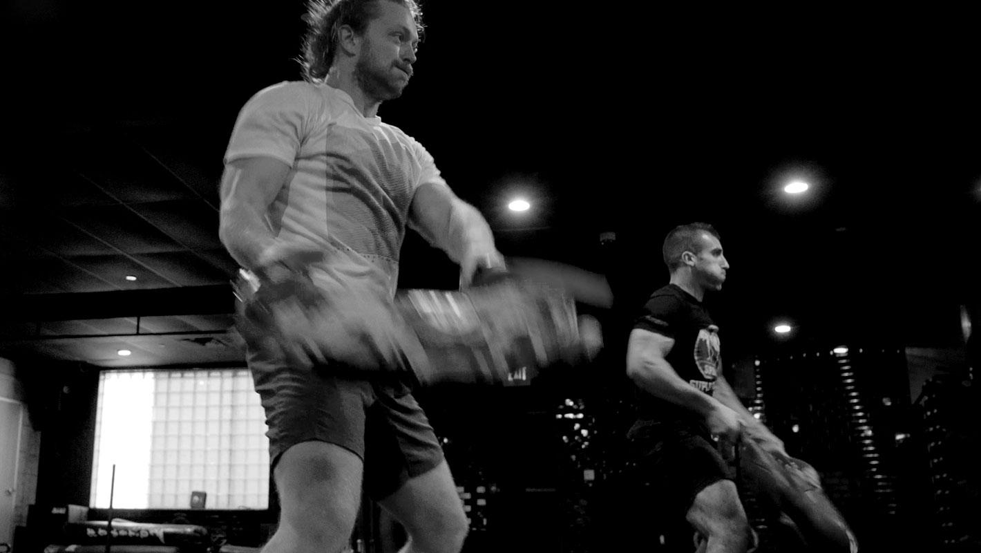 Aleks doing physical training exercises YouTube screenshot